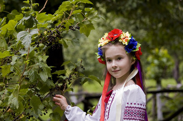 girl in ukrainian national costume posing outdoors