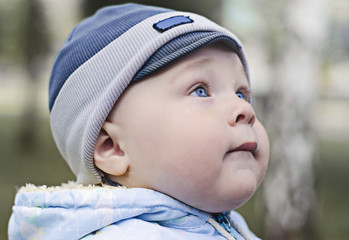 young boy with blue eyes  looking up