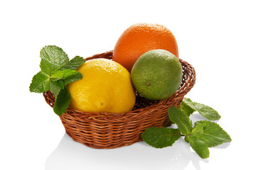 Citrus fruits in a basket and mint leaves