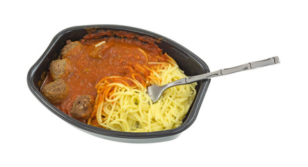 Microwaved spaghetti and meatball TV dinner