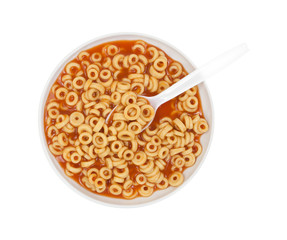 Round spaghetti in bowl with spoon