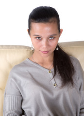 Female Asian Malay relaxing on a sofa