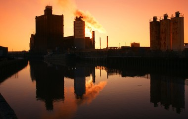 sunrise over industrial factory