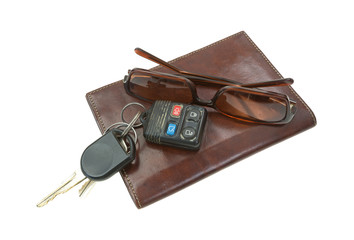 Sunglasses and car keys atop billfold.