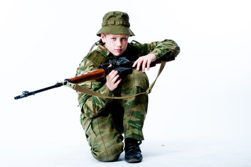 young man in camouflage with a sniper rifle
