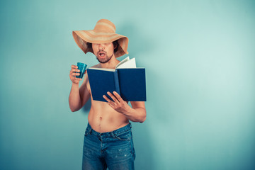 Young man wearing hat is reading