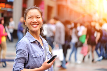 woman use smart phone at street