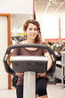 Close up portrait of young woman in the gym while training with