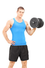 Handsome young man holding a barbell