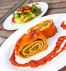 filled pasta with salad