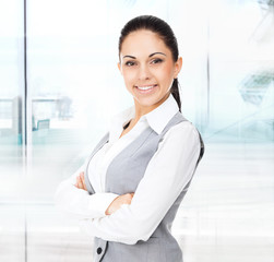 Businesswoman smile, folded hands in modern office