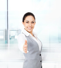 businesswoman handshake in modern office