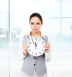 Businesswoman serious, hold clock