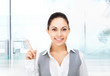 Businesswoman smile point finger empty copy space
