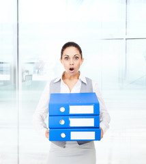 Businesswoman terrified hold stack folder