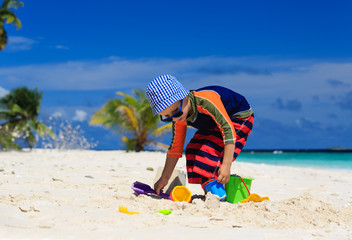 child playing on sand beach
