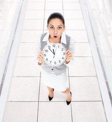 Businesswoman clock worried
