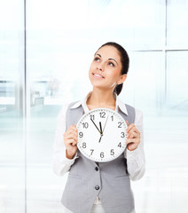 Businesswoman smile hold clock think look up