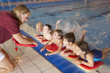 Children having swimming lesson