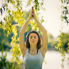 Beautiful young woman doing yoga. Concept of healthy lifestyle a