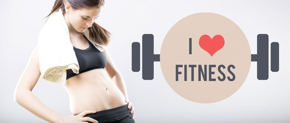 I love fitness, woman looking at her flat belly