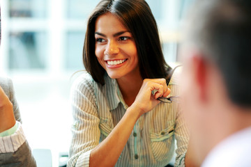 Portrait of a young smiling businesswoman at office
