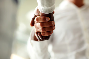 Close-up of businessmen shaking hands,