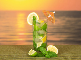 Cold drink with a lemon slice and spearmint