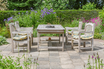 Wooden table and chairs in an ornamental garden