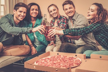Group of young multi-ethnic friends having party