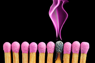 Abstract matchsticks with magenta smoke