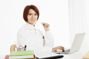 Doctor sitting behind her desk