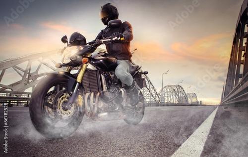 Man seat on the motorcycle on the city bridge - 66782528