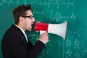 Professor Screaming On Megaphone Against Blackboard