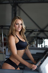 Blonde sporty woman on treadmill