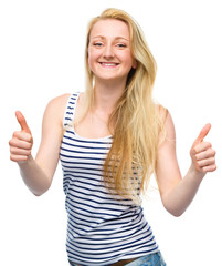 Young woman is showing thumb up gesture