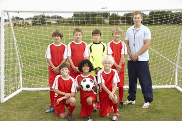 Junior football team and coach portrait