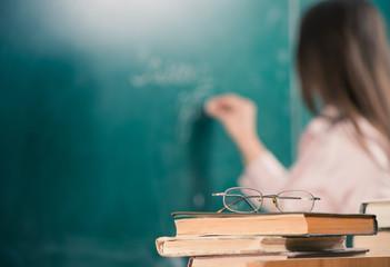 teacher books and glasses closeup