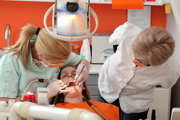 Dental procedure, drilling tooth, student, patient, professor