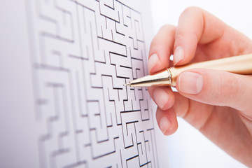 Businesswoman Solving Maze Puzzle