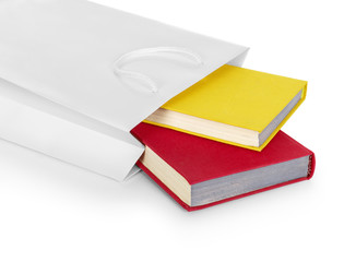 white gift bag with books on an isolated white background
