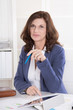 Portrait: Ältere attraktive Business Frau sitzend