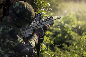 Thai soldier in action shooting