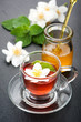 Herbal tea with mint, jasmine flowers and honey.