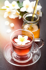 Herbal tea with jasmine flowers and honey