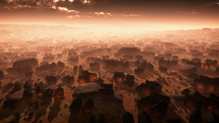 Aerial of remote desert city at sunset in the mist. Lights in ho