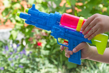 Child with a water pistol outdoors