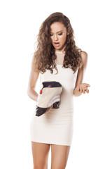 unhappy girl holding a woman's purse