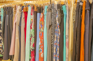 Womens clothes hanging on a rail