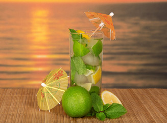 Mojito with umbrellas, juicy lime and lemon